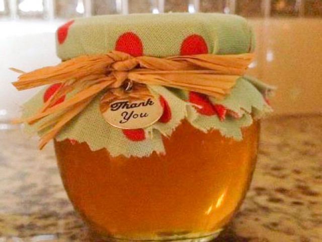 Fabric covered lid with thank you charm Homemade DIY Honey Jar Wedding Favor Idea