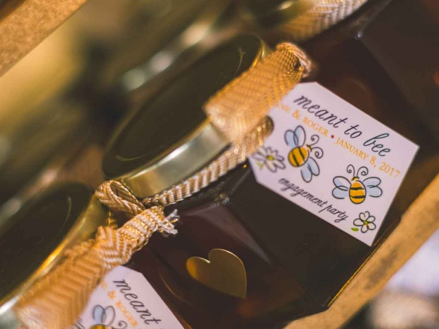 A gold heart label Homemade DIY Honey Jar Wedding Favor Idea