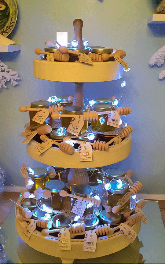Displayed on multi levels Homemade DIY Honey Jar Wedding Favor Idea