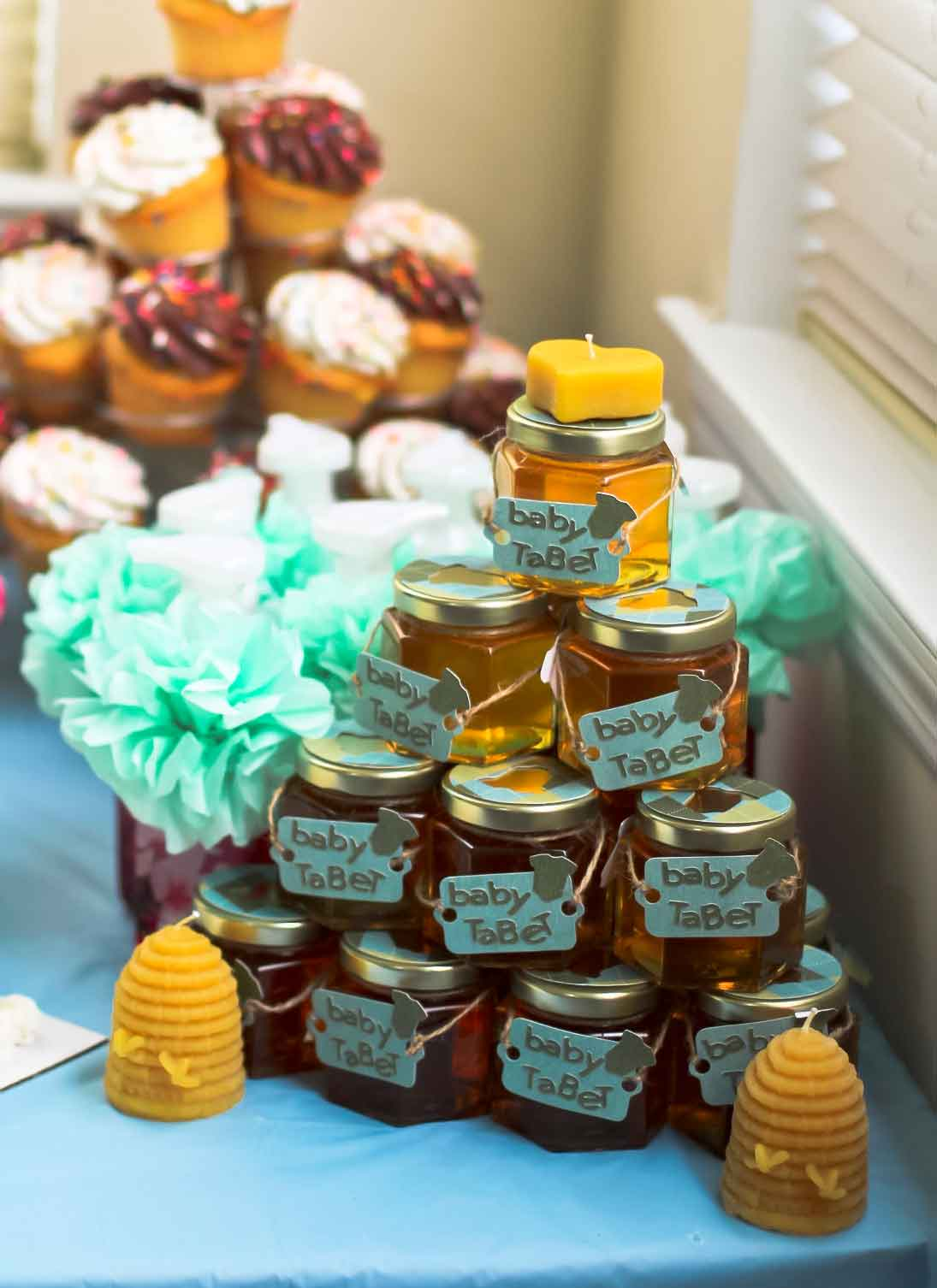 favors displayed with beeswax candles Homemade DIY Honey Jar Wedding Favor Idea