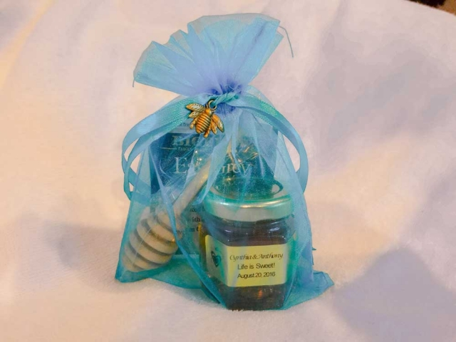 Blue organza bag with tied bee pendant Homemade DIY Honey Jar Wedding Favor Idea