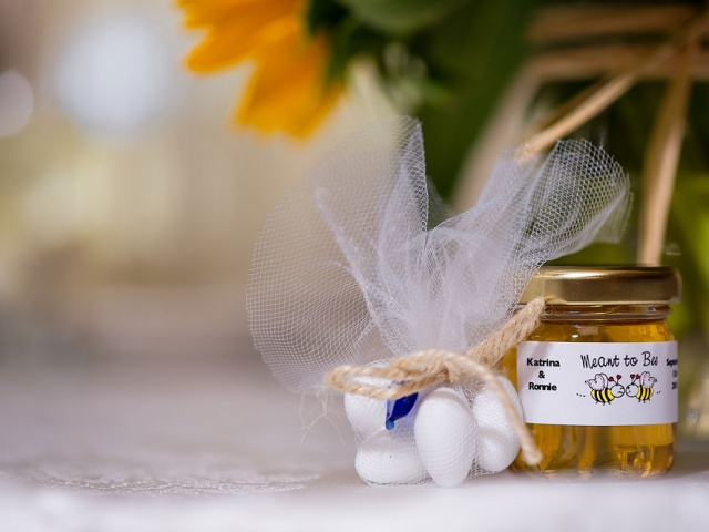 Organza bag with covered almonds Homemade DIY Honey Jar Wedding Favor Idea