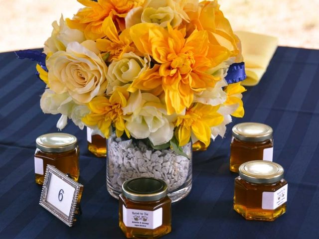 Favors displayed around center piece Homemade DIY Honey Jar Wedding Favor Idea