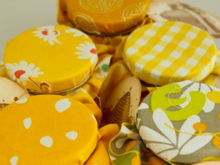 Multi colored fabric covered lid  Homemade DIY Honey Jar Wedding Favor Idea